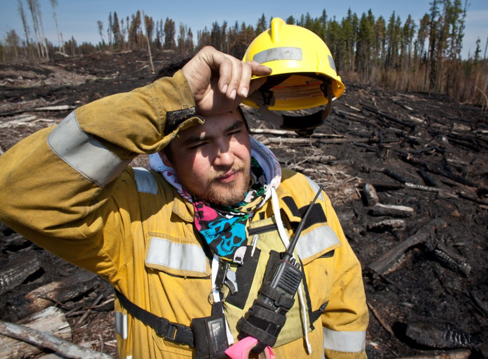 Marcel Desjarlais, Crew Leader with Alberta Sustainable Resource Development wipes his brow after fighting forest fires for three days in a row. Marcel was at the south east corner of a fire near Fox Creek, Alta. on May 19, 2011.
