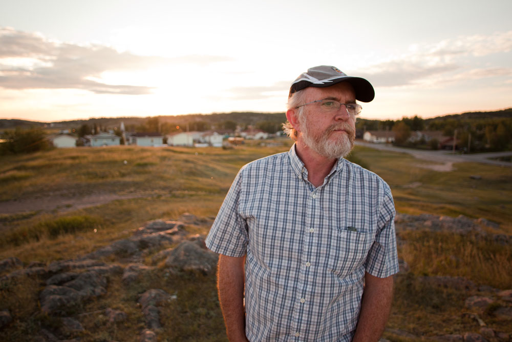 Dr. John O'Connor poses for a photo above Fort Chipewyan, Alta. on August 25, 2010. O'Connor first voiced his concerns in 2006 of elevated levels of rare cancers and diseases with the residents of Fort Chipewyan which is downstream on the Athabasca river from oilsands industry in Fort McMurray.