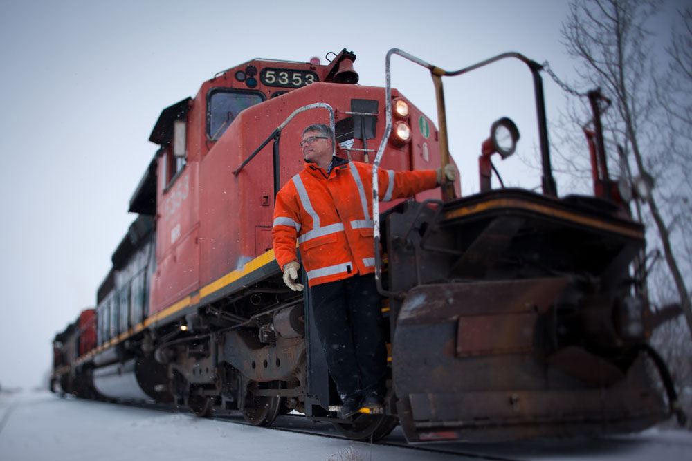 Will Munsey, volunteer Engineer for the Battle River Railway, poses for a photo in Forestburg, Alta. on December 1, 2012.  The BRR is a community-owned railway line between Camrose and Alliance, Alta. The new generation co-op purchased the 80-km short-line from CN in 2008 after they announced they were going to sell off the rails for scrap. By keeping the line active, local area farmers are able to save money and time transporting their grain. The co-op also turns a profit which it returns to it's shareholders and plans to offer tourism and oil transport in the future.