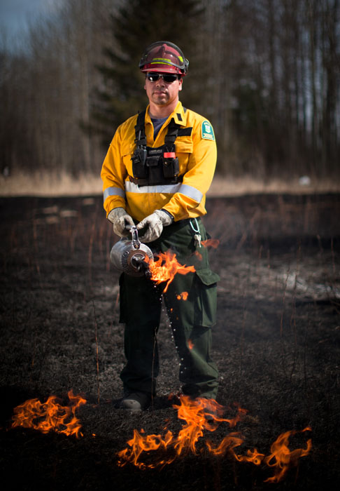 Sheldon Houle, Helitack Leader with Alberta Sustainable Resources Development shows a controlled burn in Slave Lake, Alta. on May 2, 2012.   Dry grass is burned away every spring in hazardous areas to reduce the risk of wildfires.
