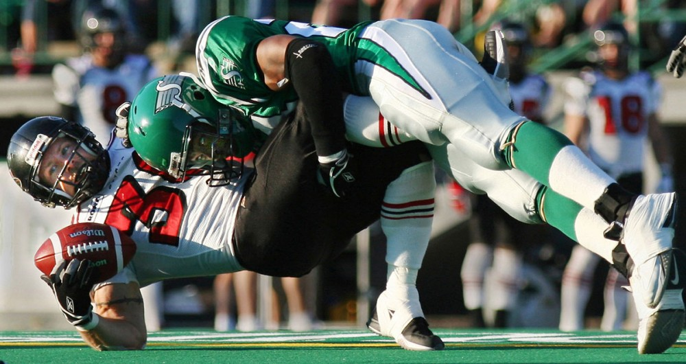 Reggie Hunt of the Saskatchewan Rough Riders takes down Josh Ranek of the Ottawa Renegades in the hardest hit of the game. Unfortunately Ottawa hit back with a 21-16 win. 2005.