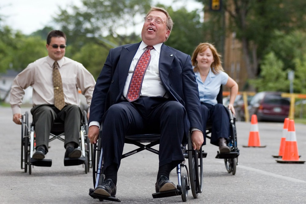 Mayor Don Atchison sighs with relief as he wins a celebrity wheel chair race in front of City Hall July 25, 2005. The event was to kick off the Sixth Annual Wheelchair Relay Campaign for the Canadian Paraplegic Association.