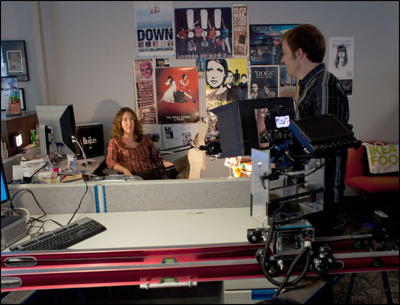 Sandra Sperounes at her desk talking about the Paul McCartney concerts. Photo by Megan Voss.