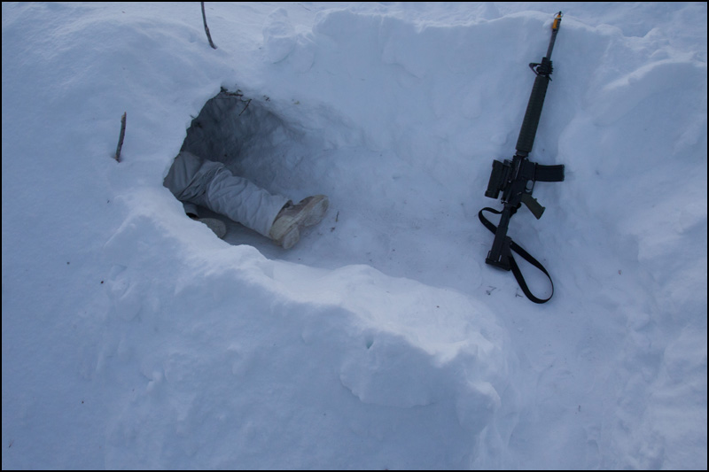 8 Platoon commander Lt. Nick Ethier climbs into a snow cave built during winter survival training with the Canadian Rangers at Forward Operating Base Maiden 1 during Exercise Arctic Ram near Yellowknife on February 14, 2012. Approximately 1,500 Canadian soldiers and Rangers participated in Arctic Ram to re-familiarize the army with a harsh winter environment and to exercise Canada's Arctic sovereignty.  (Ryan Jackson / Edmonton Journal)