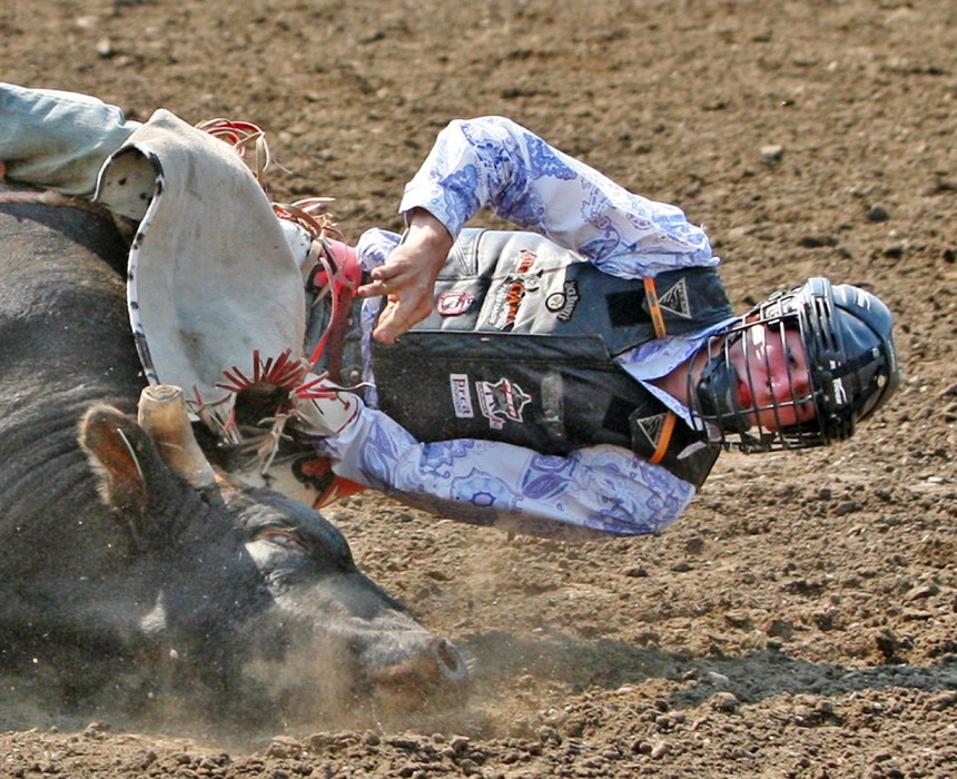 Joe Guze gets a little too close to the ground for comfort during the Bulls for Breakfast event at the Big Valley Jamboree in Camrose, Alta. on July 29, 2010.