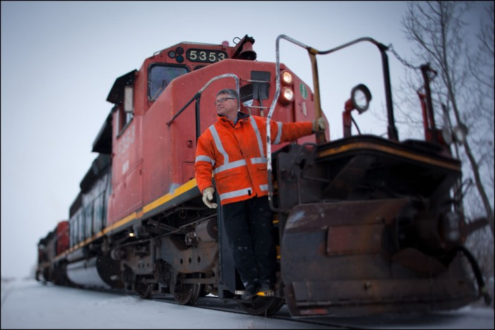 Will Munsey, volunteer Engineer for the Battle River Railway, poses for a photo in Forestburg, Alta. on December 1, 2012.  The BRR is a community-owned railway line between Camrose and Alliance, Alta. The new generation co-op purchased the 80-km short-line from CN in 2008 after they announced they were going to sell off the rails for scrap. By keeping the line active, local area farmers are able to save money and time transporting their grain. The co-op also turns a profit which it returns to it's shareholders and plans to offer tourism and oil transport in the future.  [Note: Munsey is also the president of the Alberta Party. That is unrelated to the story]  (Ryan Jackson / Edmonton Journal)