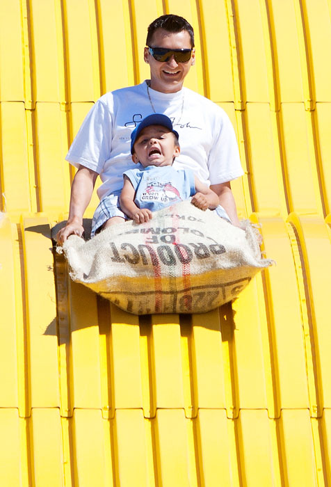 Three-year-old Preston Whitford looks terrified as he goes down the Kinsmen Giant Slide with his father Lawrence at Capital Ex in Edmonton on July 25, 2010.