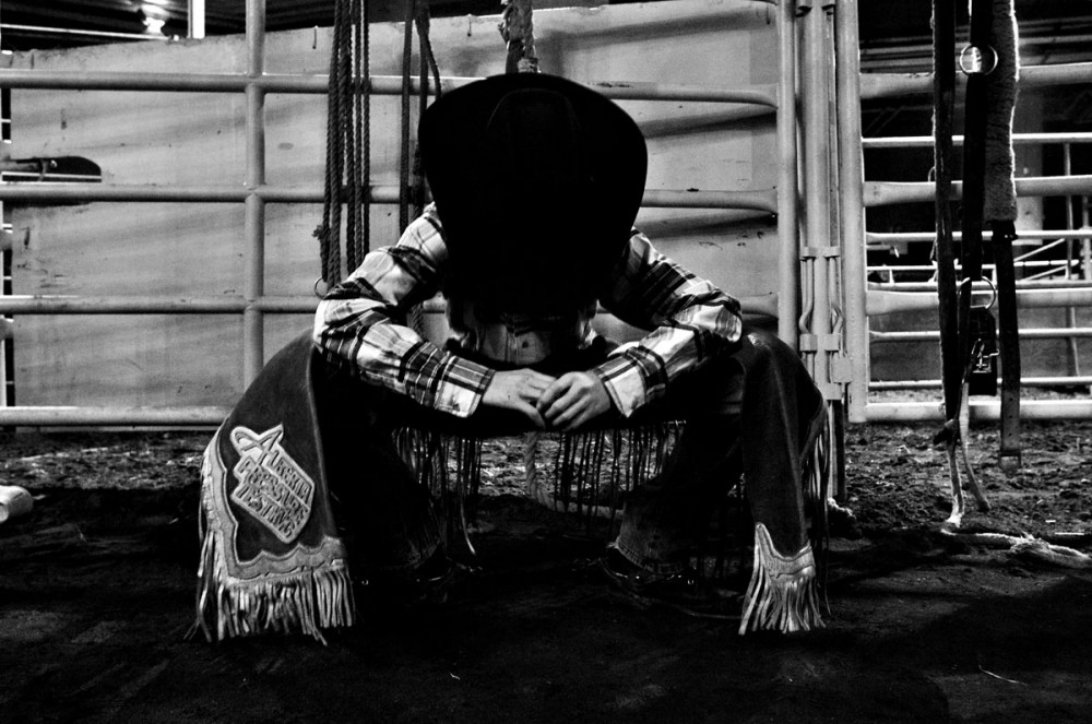 Billy West stretches before competing in the steer wrestling event at Canadian Finals Rodeo at Rexall Place in Edmonton, AB on November 8, 2008.
