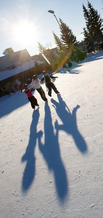 >A trio of seven-year-olds, Seneca Boisvert, left, Kohi Bundred and Bella Rusk, skate in perfect synchronicity with their lengthening shadows.