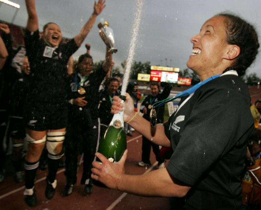 New Zealand's team captain Farah Palmer(#2), right, sprays champagne to celebrate their World Championship over England in the IRB Women's World Cup of Rugby Sunday September 17, 2006.