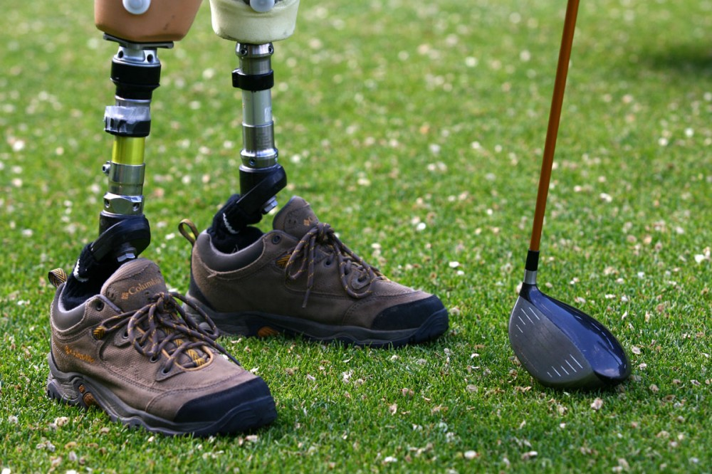 Handicapped golfer Paul Hebert pauses a moment while playing a round of golf at the Derrick Golf Club, 3500 119 St. Monday June 4, 2007. Hebert lost his two legs, an arm, and fingers on one hand when he was severely electrocuted on the job. Golf helps Hebert get out and feel like a normal member of society.