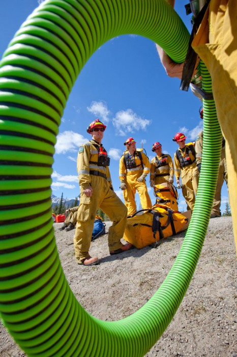 Students wait to start their pump and hose exercises during wildland firefighting training at the Hinton Training Centre run by Alberta Sustainable Resource Development in Hinton, Alta. on April 23, 2010.