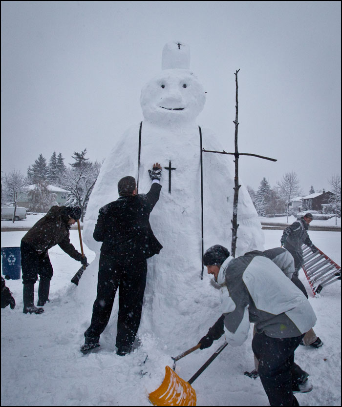 "Students with St. Joseph Seminary created a giant ""Snow Pope"" in honour of Edmonton's Archbishop Joseph McNeil society in Edmonton on November 7, 2012. There was supposed to be a fundraiser for the Archbishop Joseph MacNeil Society at the seminary but it was canceled due to weather so the students spent their day creating the sculpture and shovelling sidewalks for neighbours. For a fun video of the students creating the ""Snow Pope"" go to edmontonjournal.com/videos  (Ryan Jackson / Edmonton Journal)"