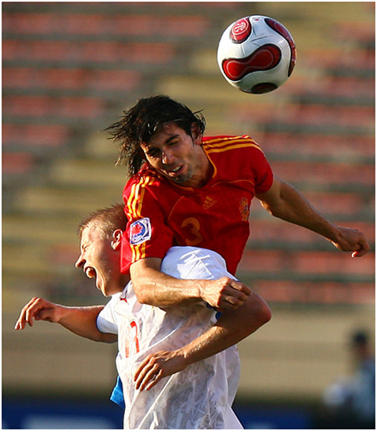 Spain's Jose Crespo (3), right, and Czech Republic's Tomas Micola (13) head the ball  during FIFA U-20 World Soccer action at Commonwealth Stadium in Edmonton, AB, Saturday July 14, 2007.