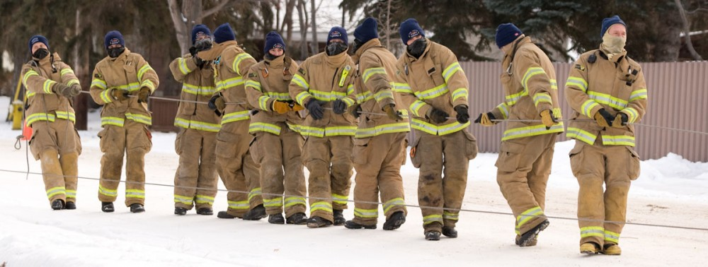 Edmonton Fire Rescue crew pull their rescue boat up from the river at the scene of a truck that crashed over a barricade and went into the North Saskatchewan river near on December 13, 2008. The driver survived the crash and walked up the river valley to safety.