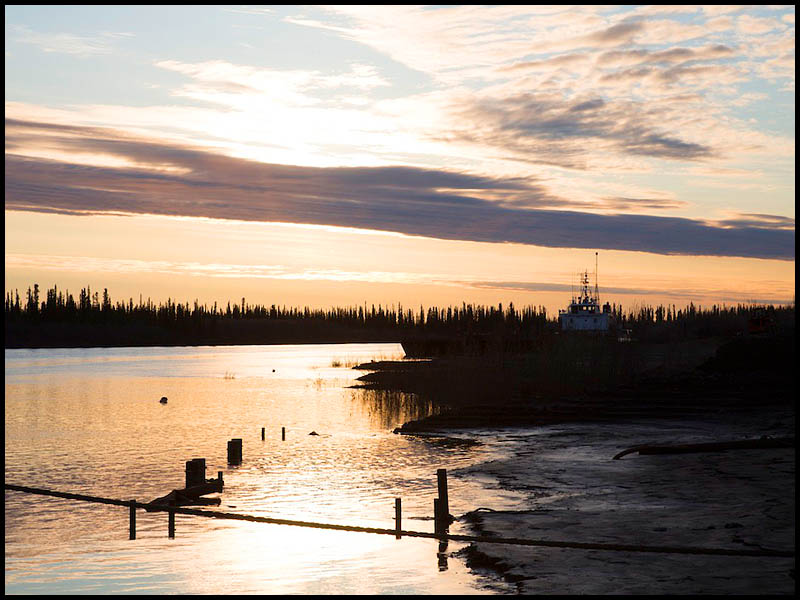 NWT Inuvik to Tuk FP story -  The sun sits on the horizon during 24 hours of daylight over the Mackenzie River. Inuvik NWT. Photo: Ryan Jackson. June 11, 2013. Financial Post