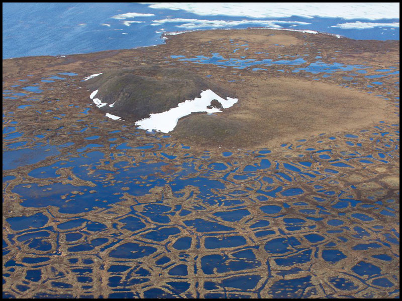 NWT Inuvik to Tuk FP story -  Aerial shot of a collapsed pingo on the Arctic tundra. Pingoes are large mounds of earth that cover a core of ice. Tuktoyaktuk, NWT. Photo: Ryan Jackson. June 10, 2013. Financial Post