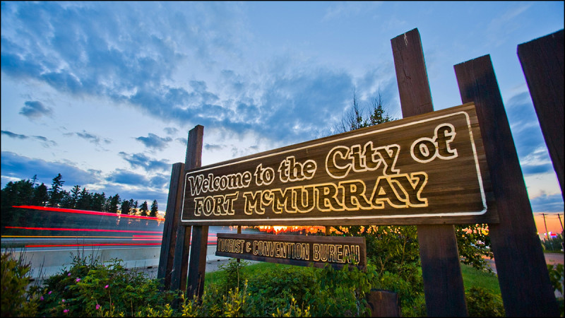 FORT MCMURRAY, ALTA.:   JUNE,19, 2013:  A Welcome to Fort McMurray sign stands on the side of Highway 63 on the south end of Fort McMurray, Alta. on June 19, 2013. (Ryan Jackson / Edmonton Journal)