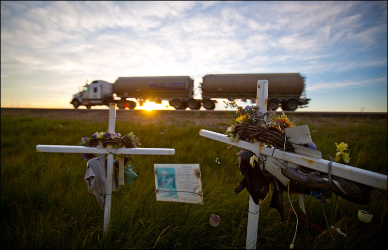 FORT MCMURRAY, ALTA.: SEPTEMBER, 7, 2013: —Roadside marker crosses Tanya Zwaan and Ione Curr who died on December 13, 2010 along Highway 63 in northern Alberta, 92.2 km south of Fort McMurray, Alta. on September 7, 2013. More than 170 people have died on Highway 63 in the last 10 years. (Ryan Jackson / Edmonton Journal)