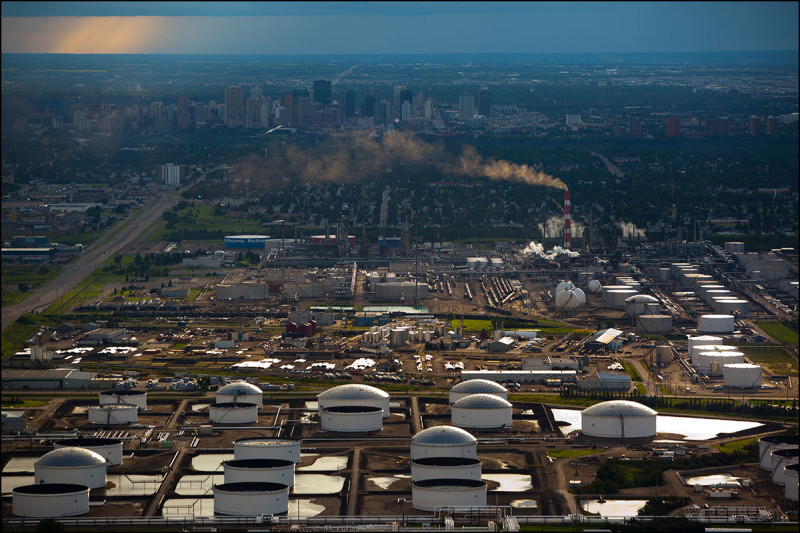 EDMONTON, ALTA.: JULY, 31, 2011: — An aerial view of the Imperial Oil Strathcona refinery with the Kinder Morgan and Enbridge oil terminals in the foreground and the Edmonton skyline in the background on July 31, 2011. The area is part of Alberta's Industrial Heartland. (Ryan Jackson / Edmonton Journal)