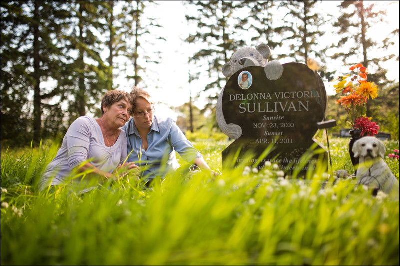 WARBURG, ALTA.: JULY,26, 2013: — Marilyn Koren and her daughter Jamie Sullivan pose for a photo at the gravesite of Jamie's daughter Delonna Sullivan near Warburg, Alta.  on July 26, 2013.  (Ryan Jackson / Edmonton Journal)