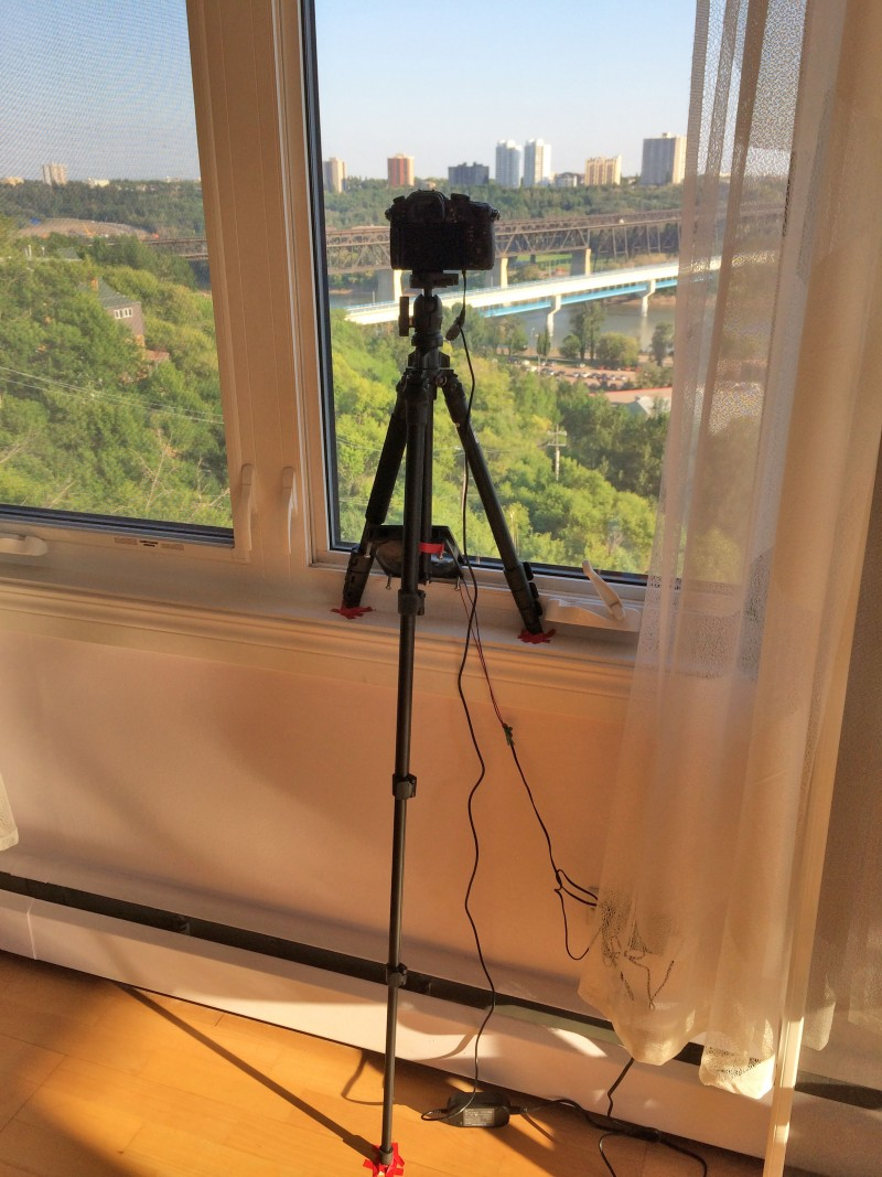 Here is my Panasonic GH3 shooting the time lapse photos of the bridge from my friend Patrick's apartment. You can't see it in this photo but I covered the camera with black tinfoil and taped it to the window so that there weren't any reflections on the glass. You can also see a small fan under the camera to keep it cool in the sunlight. Although I shot a couple weeks of photos I only used photos from the day that Brent and Bruno were on the bridge as they actually looked the most interesting.