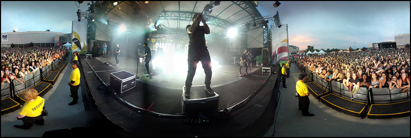 """Simple Plan performs on the Telus Stage at Capital Ex on July 28, 2012. This image was created by stitching multiple pictures together. The Journal's Ryan Jackson has created a fun """"choose your own adventure"""" style 360-degree panoramic tour of Capital Ex including 360-degree videos on a roller coaster and several other rides. You can eat corn dogs, play games and watch the fireworks.  The game is especially neat on a gyro-enabled iPad2 or iPhone 4.  Go to http://www.edmontonjournal.com/capex360    (Ryan Jackson / Edmonton Journal)"""