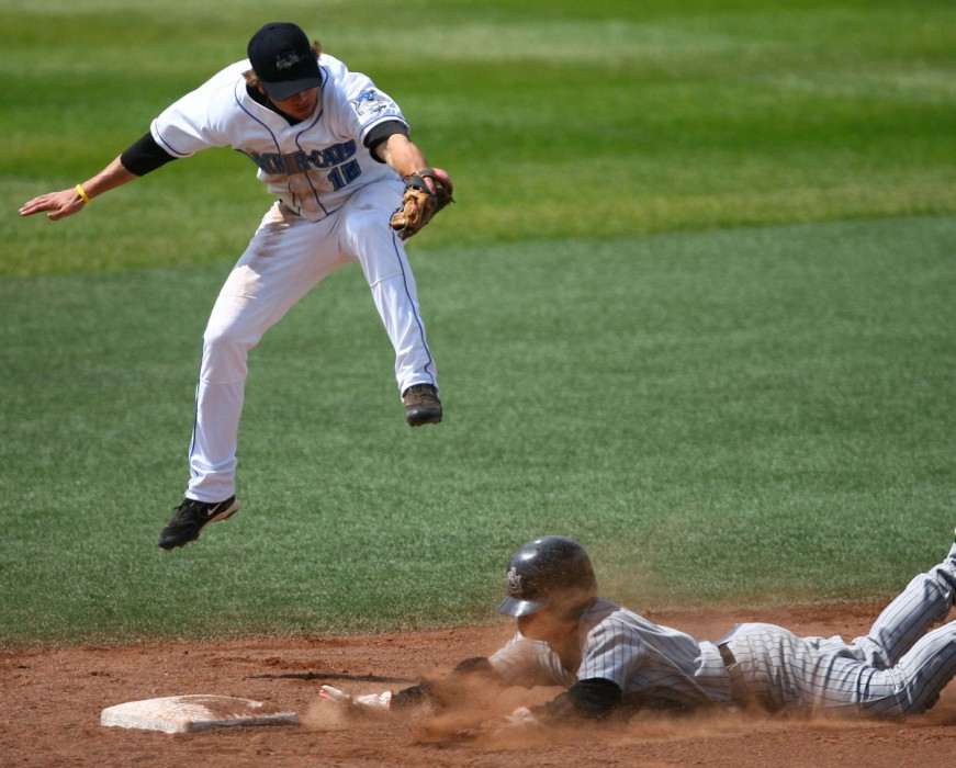 Edmonton Cracker Cats' Chris Becker tries to tag out Calgary Vipers' Manabu Kuramochi at the bottom of the fourth inning during the Northern League series finale at Telus Field Sunday. Kuramochi made it safe to second. 2007.