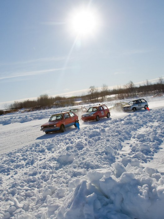 Cars speed around the track during the first rubber race at the Northern Alberta Sports Car Club Ice Racing event at Telford Lake near Leduc on January 31, 2009.